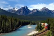3017140 - freight train moving along bow river in canadian rockies