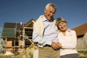 23853359 - senior couple in front of partially built house