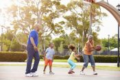42314882 - grandparents and grandchildren playing basketball together