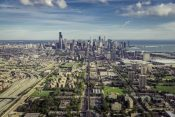 45835354 - aerial view through chicago downtown with suburbs - high angle