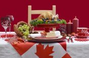 45303414 - red and white canadian theme thanksgiving table setting with flag and roast turkey chicken on large platter centerpiece .